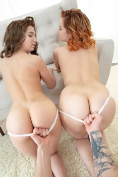 Two babes lick one cock